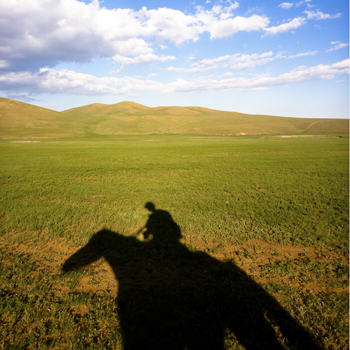 With my horse Sunshine at the Mongolian countryside