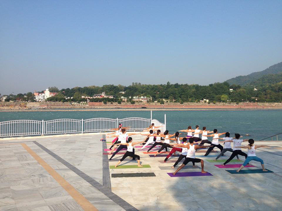 Sun salutations at the ganga in rishikesh