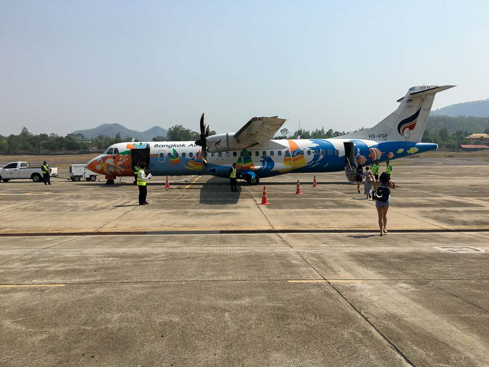 Bangkok Airways Propeller flight taxiing at the airport in Mae Hong Son
