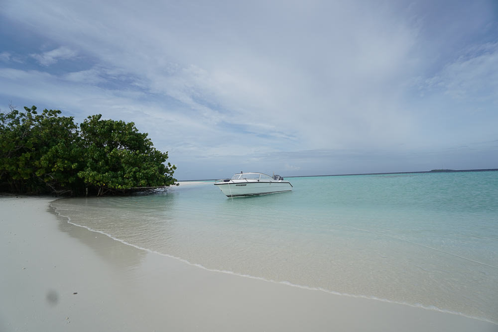 boat-at-uninhabited-island-maldives-budget-guide-24
